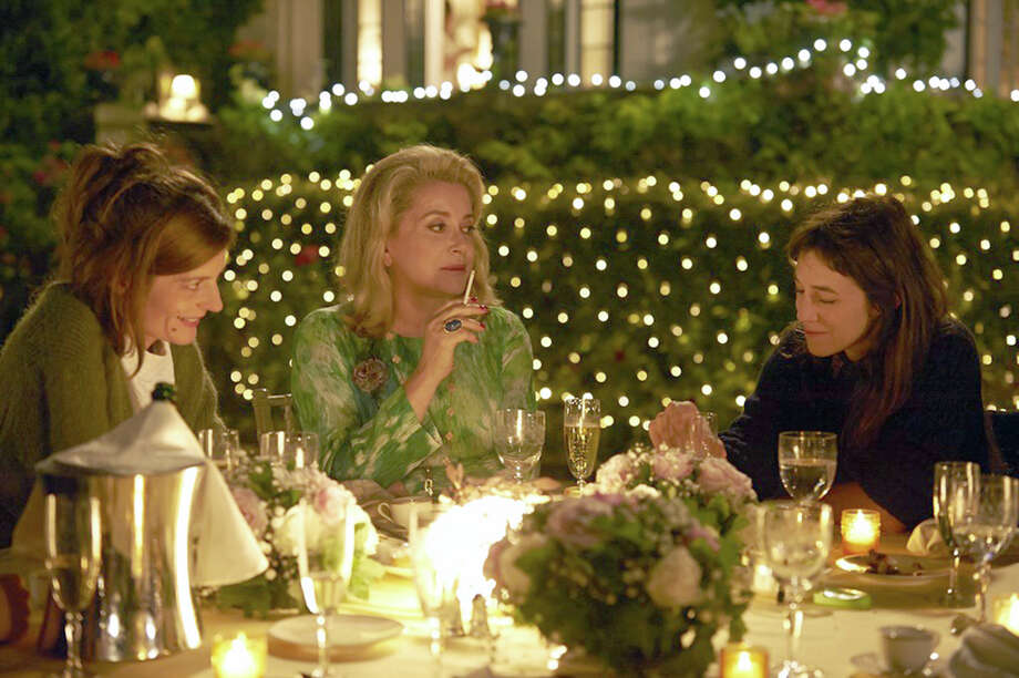"Catherine Deneuve, center, stars with her daughter Chiara Mastroianni, left, and Charlotte Gainsbourg in ""3 Hearts,"" which is being screened July 16 as part of the French Cinematheque series in Stamford. Photo: Contributed Photo / Connecticut Post Contributed"
