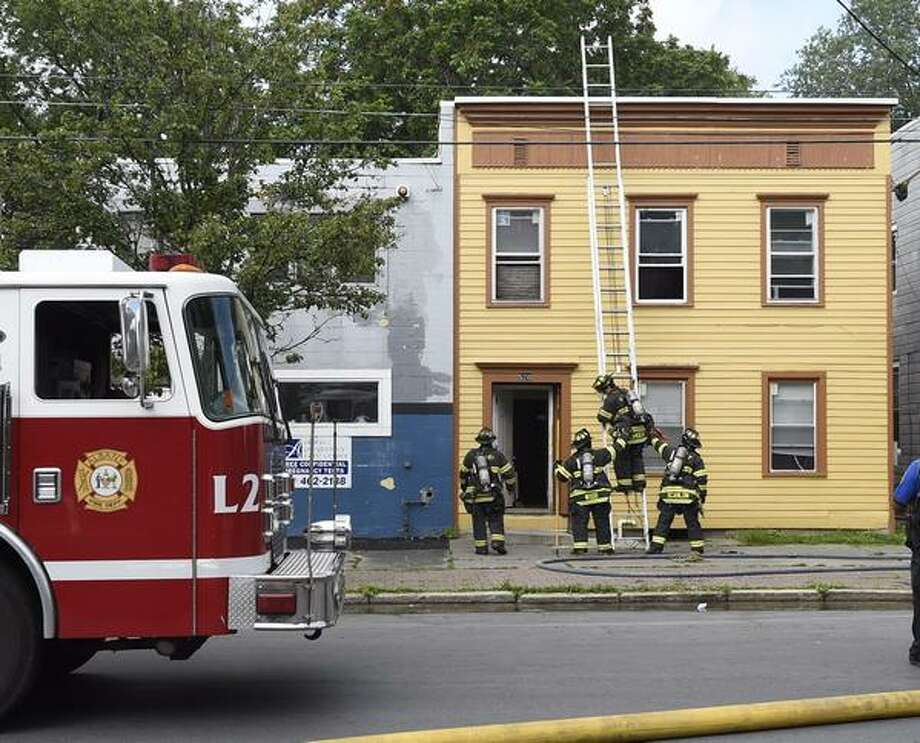 Albany firefighters battle a blaze at 520 Clinton Ave. Tuesday, July 14, 2015. (Skip Dickstein/ Times Union)