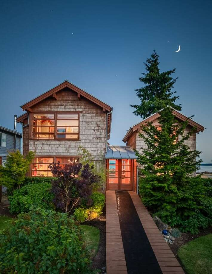 This home on Juniper Beach on Camano Island is a sandy retreat. You can enter by a boardwalk to the beach. The boardwalk also separates the guest quarters, which include a Japanese soaker tub and loft. The property is listed for $1.3 million. You can find out more about it here. Photo: Jason Hughes