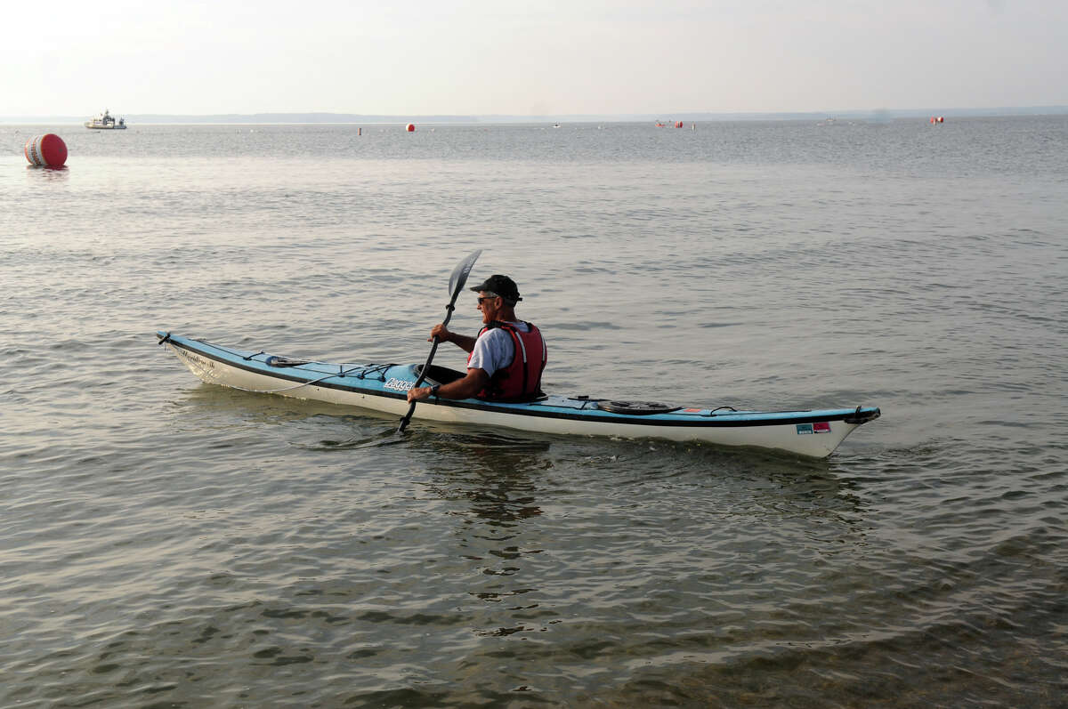 Bob DeAngelo sets out in a kayak during the One Mile Greenwich Point Swim at Tod's Point in Greenwich .