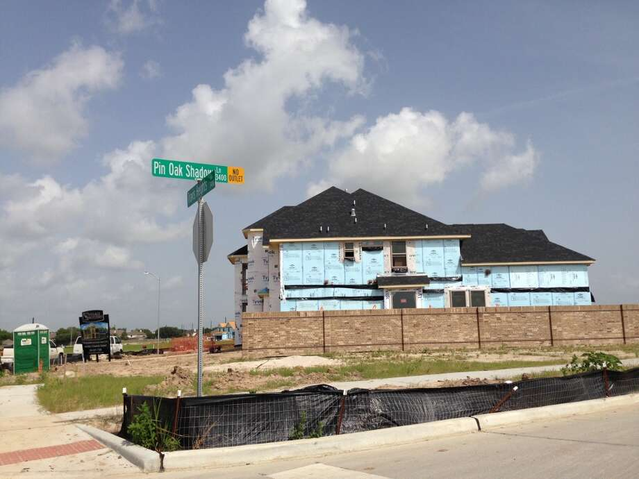 New home building in The Reserve at Clear Lake, where prices will start at close to $500,000. Photo: Katherine Feser, Houston Chronicle