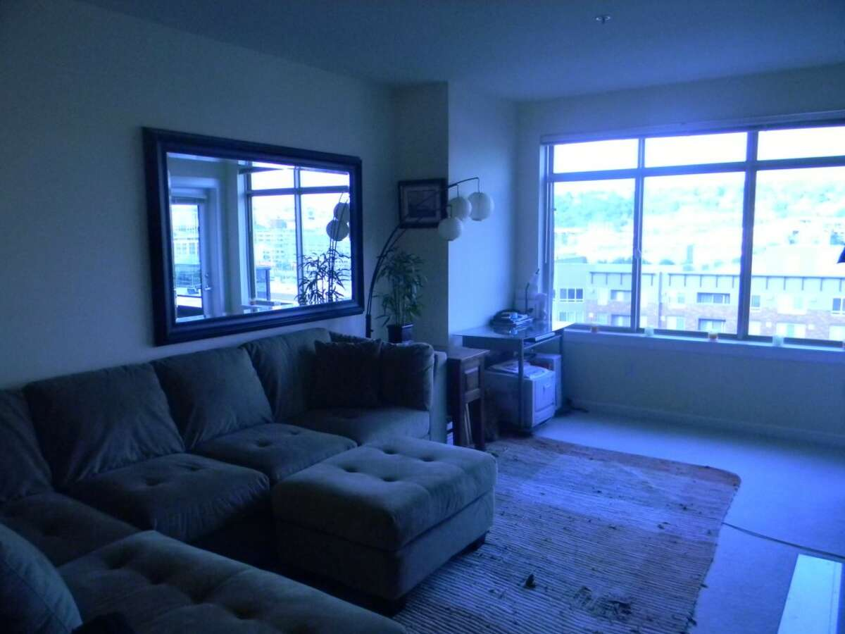 The living room in 900 Aurora Ave. N. #402