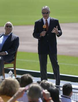 Baseball Commissioner Rob Manfred, right, gestures to AT & T Park employees beside Giants radio broadcaster Jon Miller, Thursday, June 25, 2015, prior to a baseball game between the San Diego Padres and the San Francisco Giants in San Francisco. (AP Photo/Ben Margot)
