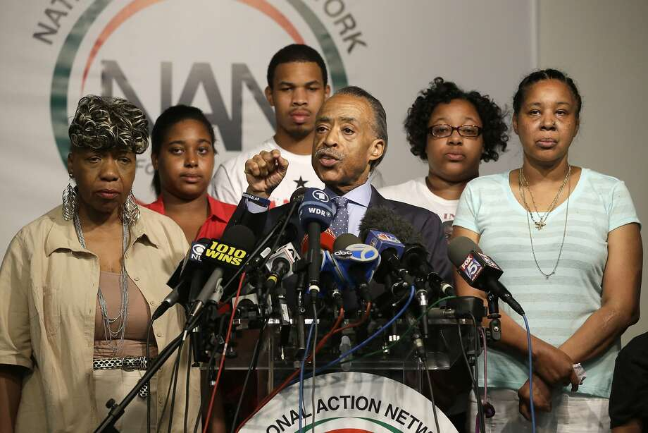 The Rev. Al Sharpton and Eric Garner's family hold a news conference in New York. Photo: Mary Altaffer, Associated Press