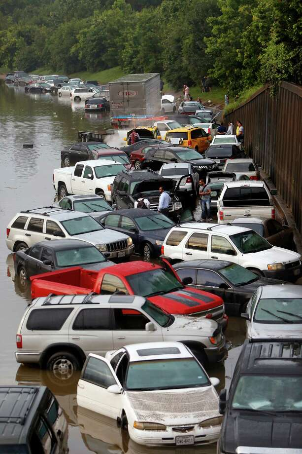 Floodwaters stranded motorists on I-45 near North Main on May 26. Area auto sales in June were up from a year earlier.   Photo: CODY DUTY, PTR / HOUSTON CHRONICLE