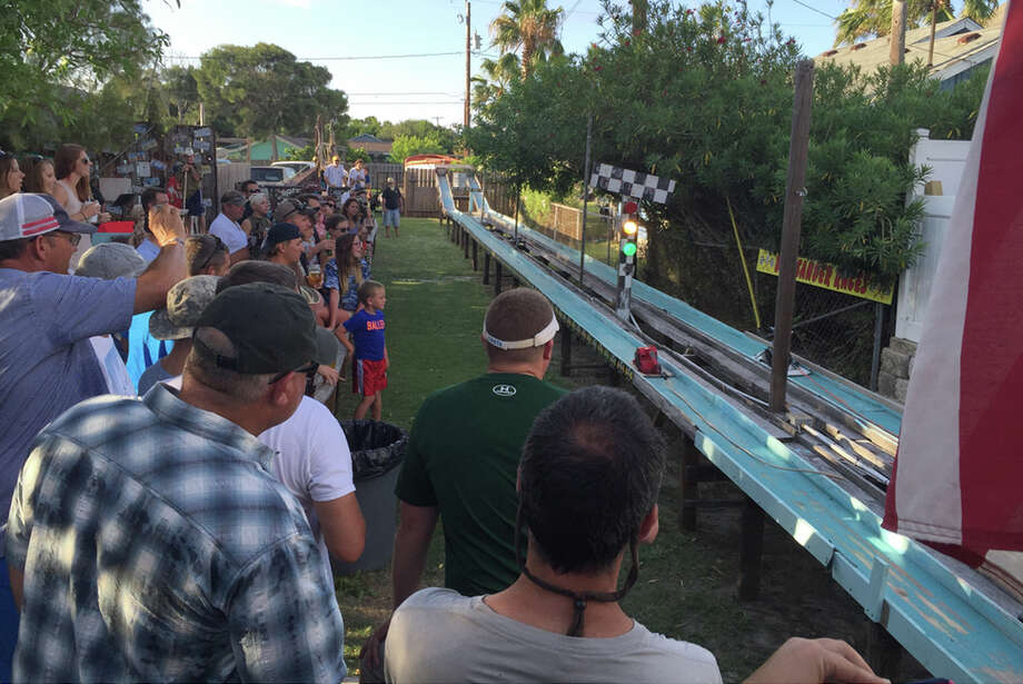 Locals gather at the Gaff, a townie-friendly bat in Port Aransas, only July 11, 2015 to watch the bi-weekly Belt Sander Races, which have been held there since 2015. The power tools are modified to make them run faster down the 75-foot-long track in the bar's beer garden. Photo: Roy Bragg / San Antonio Express-News