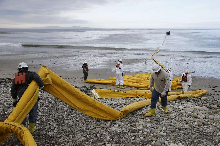 Workers last May prepared an oil containment boom at Refugio State Beach, north of Goleta. Photo: Jae C. Hong, Associated Press