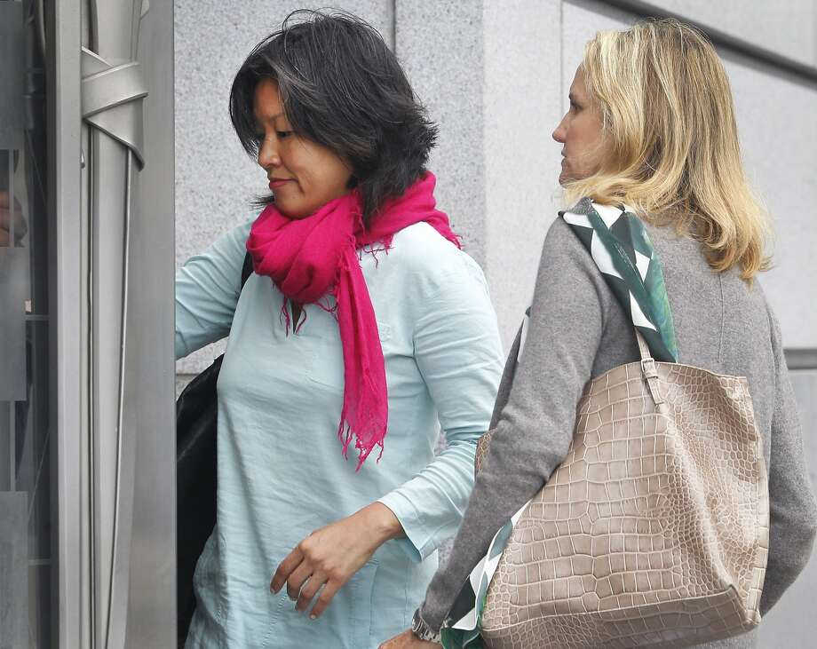 Mimi Lee (left) arrives at San Francisco Superior Court with an unidentified woman for the second day of testimony in San Francisco, Calif. on Tuesday, July 14, 2015 in her case against ex-husband Stephen Findley involving custody of their frozen embryos. Photo: Paul Chinn, The Chronicle