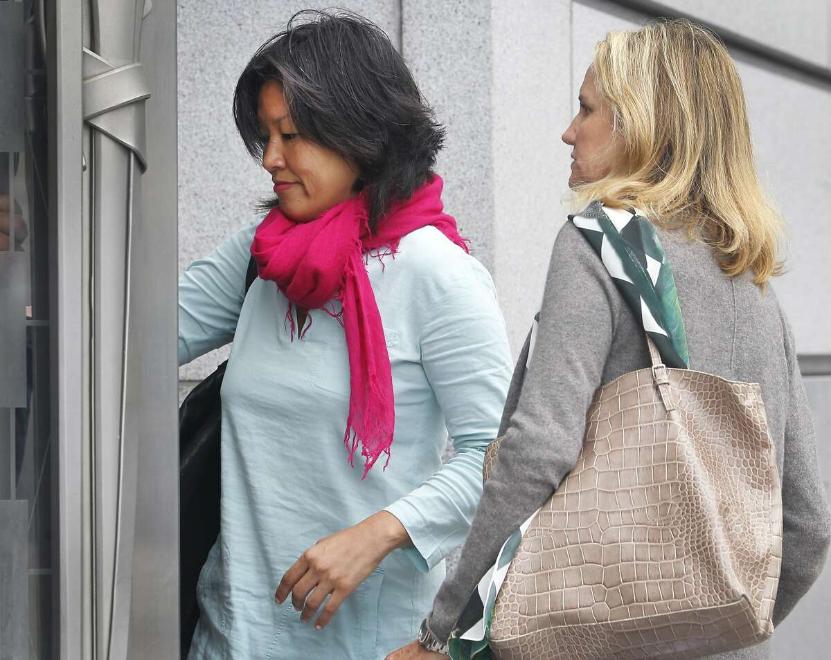 Mimi Lee (left) arrives at San Francisco Superior Court with an unidentified woman for the second day of testimony in San Francisco, Calif. on Tuesday, July 14, 2015 in her case against ex-husband Stephen Findley involving custody of their frozen embryos.