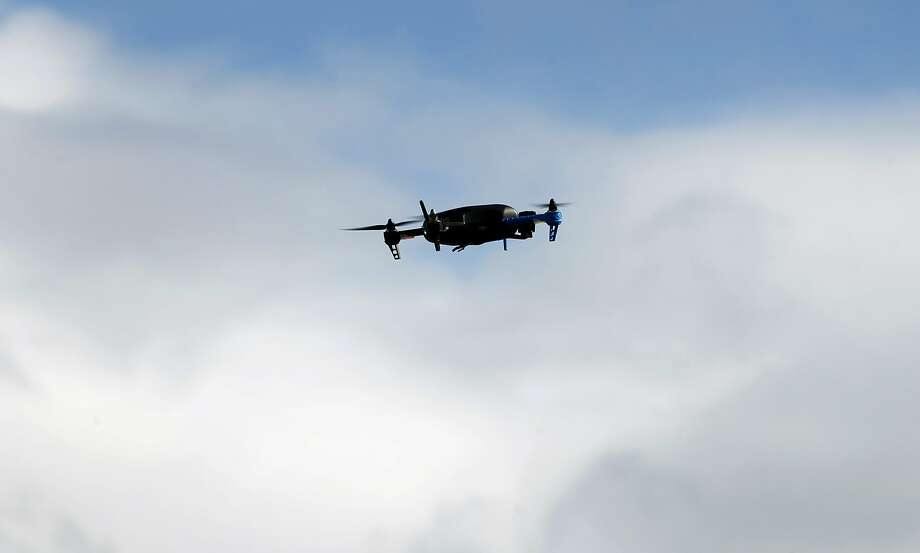 A drone hovers above Brisbane, and often fly in se cure areas near the Gold en Gate Bridge. Photo: Paul Chinn, The Chronicle