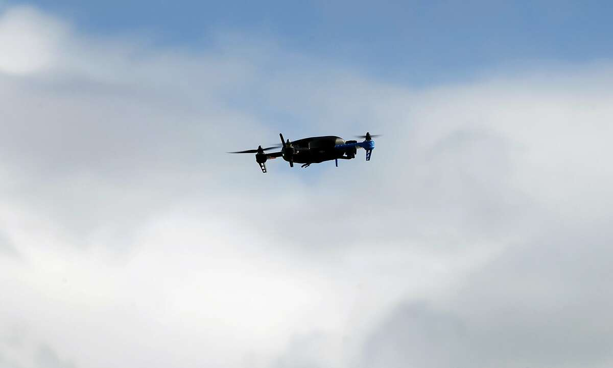 A drone hovers in the sky above Brisbane, Calif. on Friday, Feb. 27, 2015. A team of developers have created the iDroneLink system, which controls and operates drones using an iPhone or iPad. Drone use is likely to skyrocket following new rules proposed by the FAA that are less restrictive than opponents were hoping for.