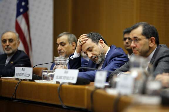 A member of the Iranian delegation reacts during a plenary session at the United Nations building in Vienna, Austria, Tuesday, July 14, 2015. (Carlos Barria/Pool via AP)