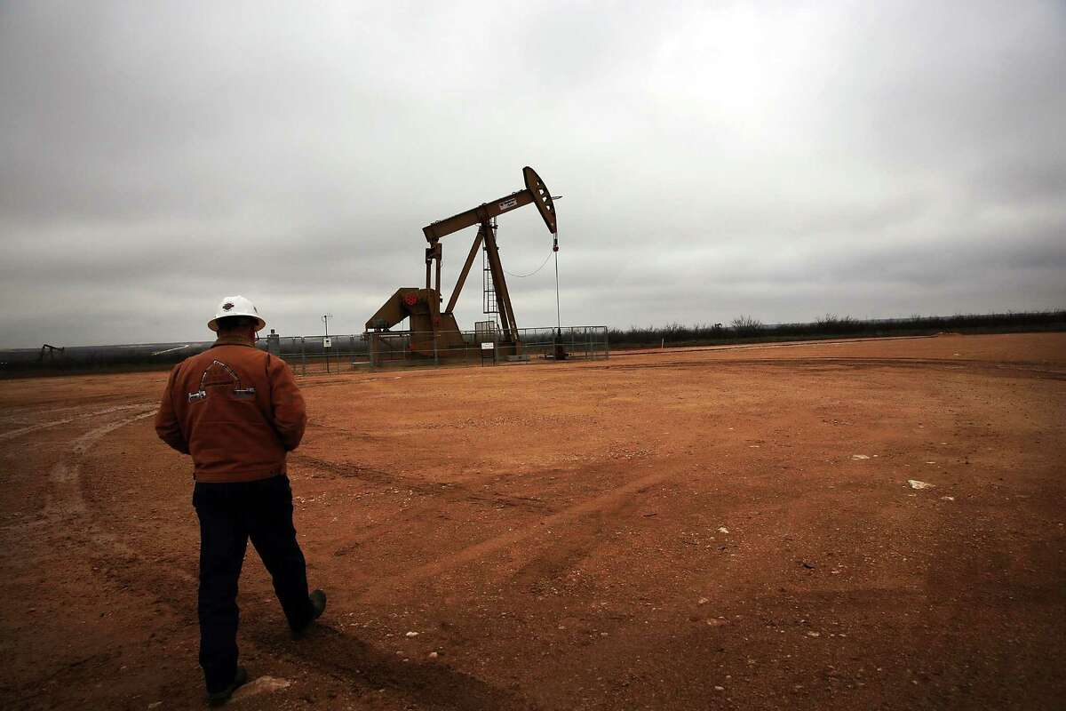 An oil well owned an operated by Apache Corporation in the Permian Basin is seen on Feb. 5, 2015, in Garden City, Texas. The well produces about 55-70 barrels of oil per day. As crude oil prices have fallen nearly 60 percent globally, many American communities that became dependent on oil revenue are preparing for hard times. Texas, which benefited from hydraulic fracturing and the shale drilling revolution, tripled its production of oil in the last five years. The Texan economy saw hundreds of billions of dollars come into the state before the global plunge in prices. Across the state drilling budgets are being slashed and companies are notifying workers of upcoming layoffs. According to federal labor statistics, around 300,000 people work in the Texas oil and gas industry, 50 percent more than four years ago. (Photo by Spencer Platt/Getty Images)