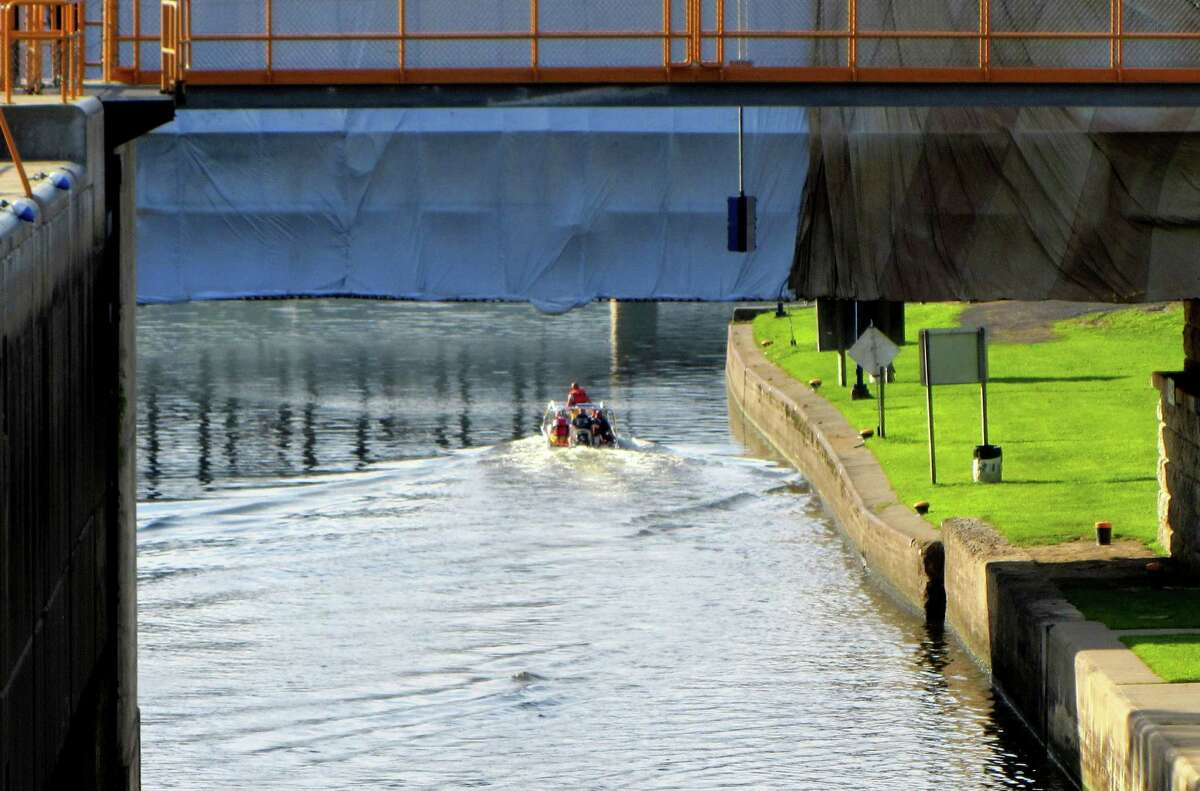 A boat removes a body from the water in Lock 2 in Waterford on Tuesday, July 14, 2015. (Bob Gardinier/Times Union)