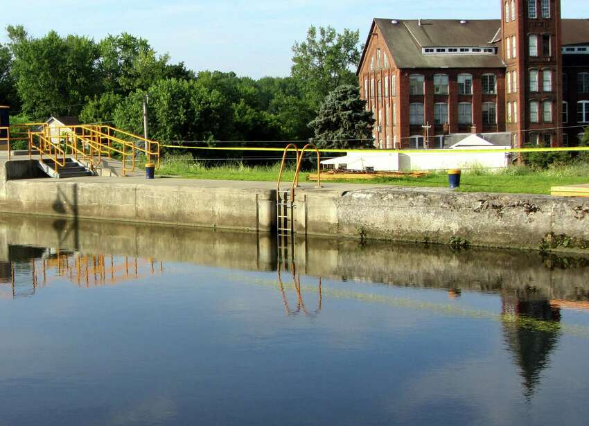 A woman out walking saw a man's body in the water at Lock 2 in Waterford early Tuesday, July 14, 2015, officials said. The body was removed by boat. (Bob Gardinier/Times Union)