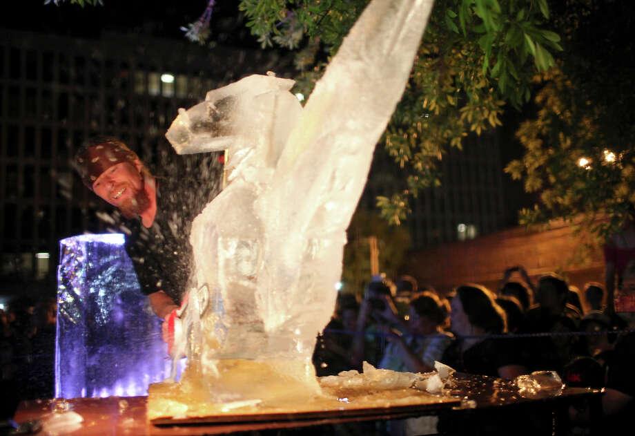 Ice sculptor Buddy Rasmussen uses a chainsaw on an ice creation during Luminaria 2011. Photo: Edward A. Ornelas /San Antonio Express-News / SAN ANTONIO EXPRESS-NEWS NFS