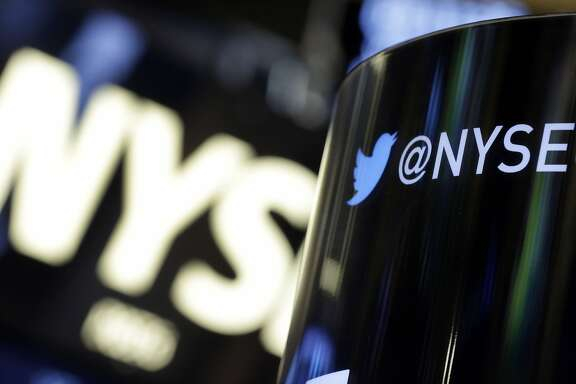 FILE - In this Monday, Nov. 4, 2013, file photo, a phone post on the floor of the New York Stock Exchange features a Twitter logo, in New York. Twitter's stock briefly spiked on Tuesday, July 14, 2015, after a fake story said the company received a $31 billion buyout offer. (AP Photo/Richard Drew, File)