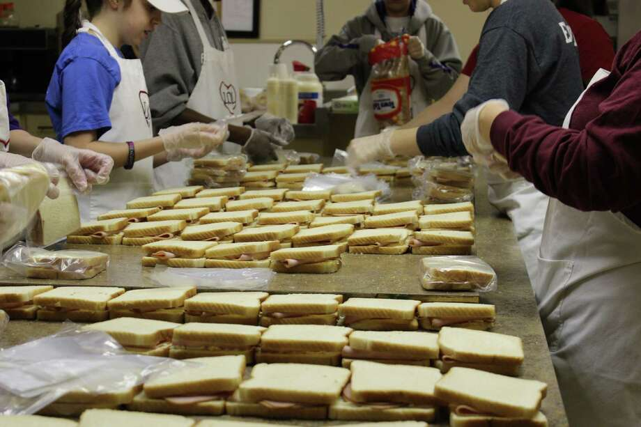 Volunteers make piles of sandwiches for Lunches of Love, which serves students in the Lamar Consolidated Independent School District.Volunteers make piles of sandwiches for Lunches of Love, which serves students in the Lamar Consolidated Independent School District. Photo: Lunches Of Love