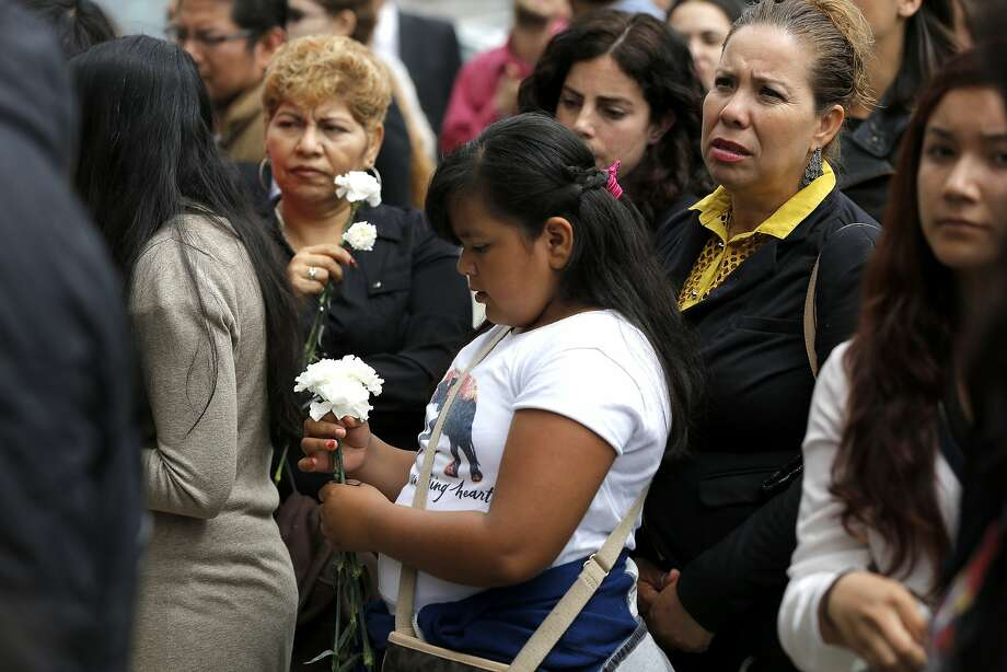 Listeners were given flowers during a news conference about immigrant rights at City Hall in San Francisco, California, on Tuesday, July 14, 2015. Photo: Connor Radnovich, The Chronicle