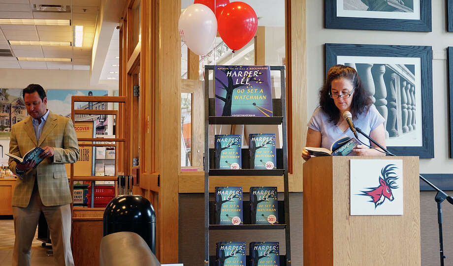"Jennifer Maxon-Kennelly, a member of the town's school board, takes a turn reading from Harper Lee's ""To Set a Watchman"" at a day-long reading Tuesday at the Fairfield University Bookstore. Waiting for his turn is author Adam Dunn. Photo: Genevieve Reilly / Fairfield Citizen / Fairfield Citizen"