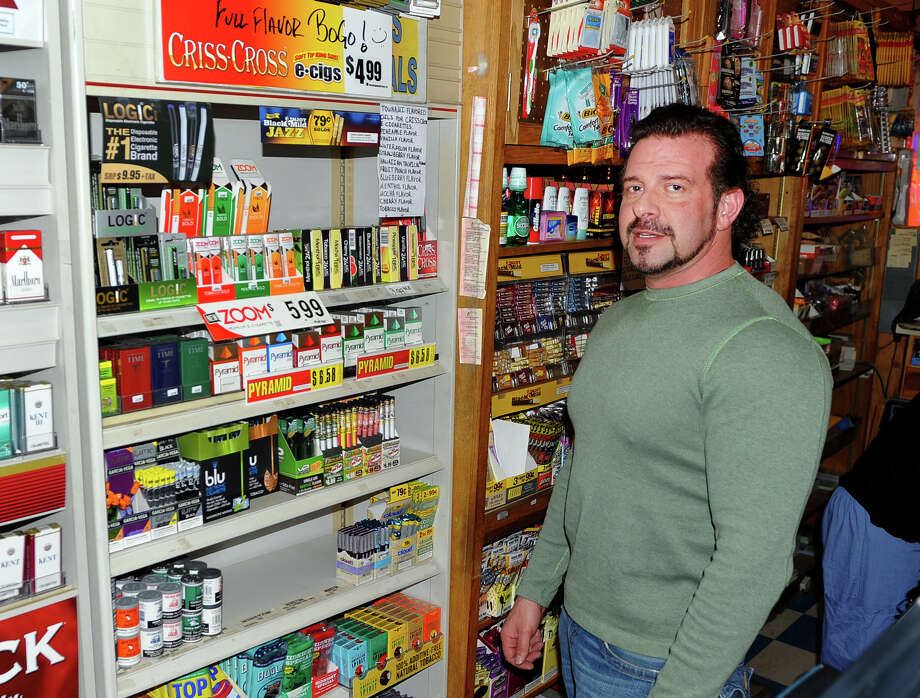 Ray Martin, owner of Martin's News & Cigarette Outlet in Stratford, Conn. and a member of the Easton Police Commission was charged Tuesday July 14, 2015 in connection to a steroid/prescription drug ring. Martin, 48, of Easton, was arrested by federal officials and charged with conspiracy to possess oxycodone with intent to distribute. Photo: Christian Abraham / Christian Abraham / Connecticut Post