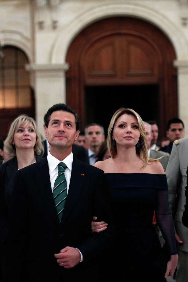 """Mexican President Enrique Pena Nieto and his wife Angelica Rivera visit the Hotel National des Invalides in Paris, on July 13, 2015. Mexican President is paying a state visit to France amid the shock of drug lord Joaquin """"El Chapo"""" Guzman's dramatic escape from a maximum security prison in Mexico. Mexico is the guest of the Bastille Day parade. The Invalides houses an army museum and former French Emperor Napoleon's tomb. Photo: Thibault Camus /Afp / Getty Images / AFP"""