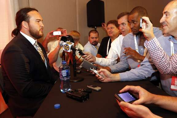 Texas A&M's Mike Matthews speaks to the media at the Southeastern Conference NCAA college football media days, Tuesday, July 14, 2015, in Hoover, Ala. (AP Photo/Butch Dill)