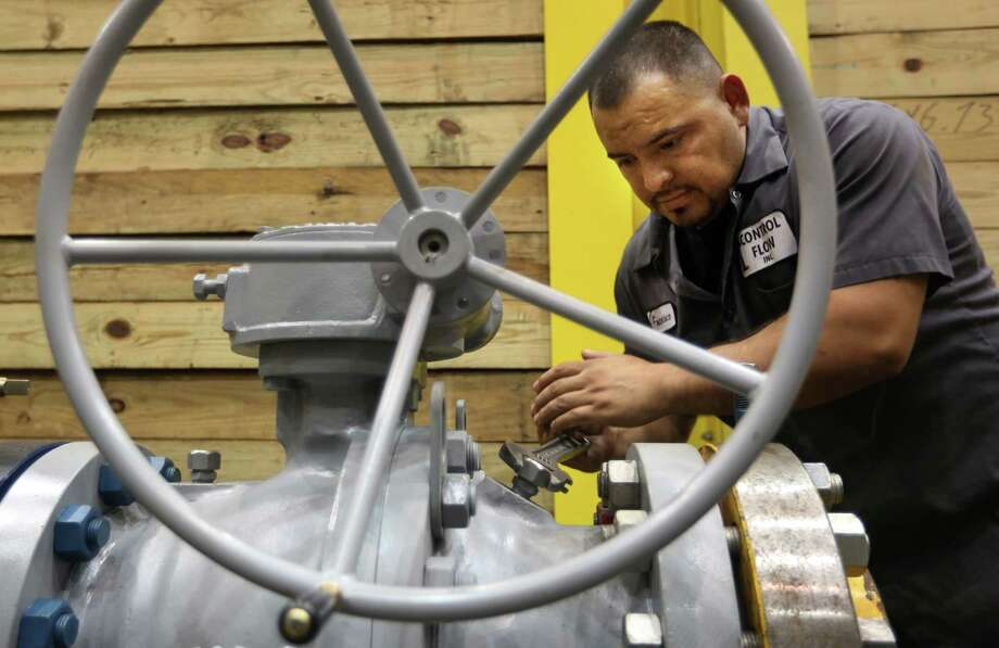 Francisco Ramirez tests an oil well head at Control Flow, which is one of many businesses that will be affected by the shutdown of  the Export-Import Bank. Photo: Mayra Beltran, Staff / © 2015 Houston Chronicle