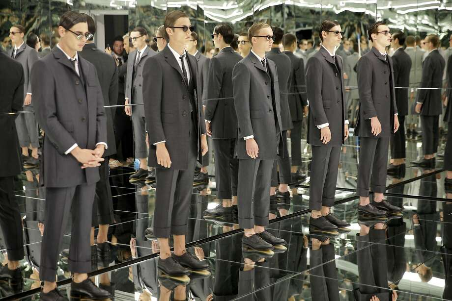 Models stand in a mirrored room during a presentation by Thom Browne at Men's Fashion Week in New York, Tuesday, July 14, 2015. Photo: Seth Wenig, Associated Press