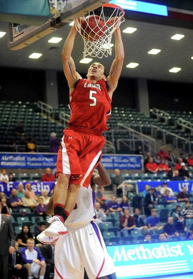 Former Lamar Cardinals basketball star Mike James is competing in the NBA Summer League as a member of the Phoenix Suns team. Lamar's Mike James puts it in the basket during the game against Stephen F. Austin at the Merrell Center in Katy, Thursday, March 8, 2012. Tammy McKinley/The Enterprise Photo: File Photo