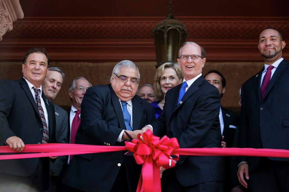 Commissioner Paul Elizondo and County Judge Nelson Wolff cut the ribbon during a rededication ceremony for the Bexar County Courthouse after the removal of the 1963 and 1970 Gondeck additions in San Antonio, Texas on July 14, 2015. The renovation restored the Bexar County Courthouse back to its original historic façade. Photo: Carolyn Van Houten, Staff / San Antonio Express-News / 2015 San Antonio Express-News