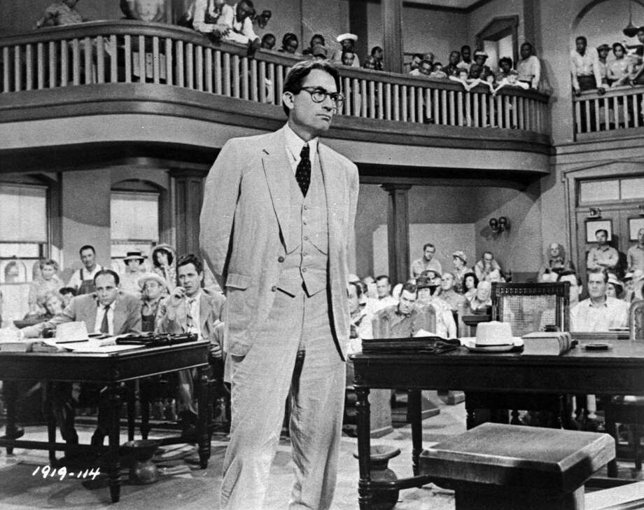 """In this 1962 photo, actor Gregory Peck is shown as attorney Atticus Finch, a small-town Southern lawyer who defends a black man accused of rape, in a scene from """"To Kill a Mockingbird,"""" based on the novel by Harper Lee. Photo: Universal / Universal"""