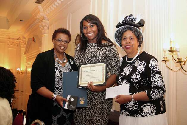 The Black Women's Association of Albany held a scholarship program honoring eight outstanding students who will each receive $1,000 once they enroll in college on June 20 at The Desmond Hotel. BWAA President Yvonne Abunaw, right, and Vice President Carolyn McLaughlin, left, present a certificate and other gifts to Xiomara Francis of Albany Leadership Charter High School for Girls. (Submitted photo)