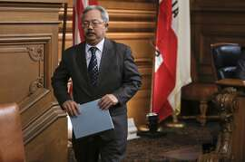 Mayor Ed Lee exits the chamber after comments to the board as the San Francisco Board of Supervisors prepared to vote on competing measures to regulate Airbnb and other short-term rental services in  San Francisco, Calif., on Tues. July 14, 2015.