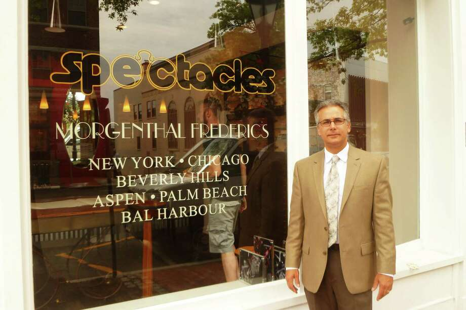 Guy Uhran, the manager of Morgenthal Frederics eyewear store in downtown New Canaan, which opened on Tuesday, July 14.  The store had been known as Spectacles in town since 1977. Photo: Martin Cassidy / Hearst Connecticut Media / Darien News