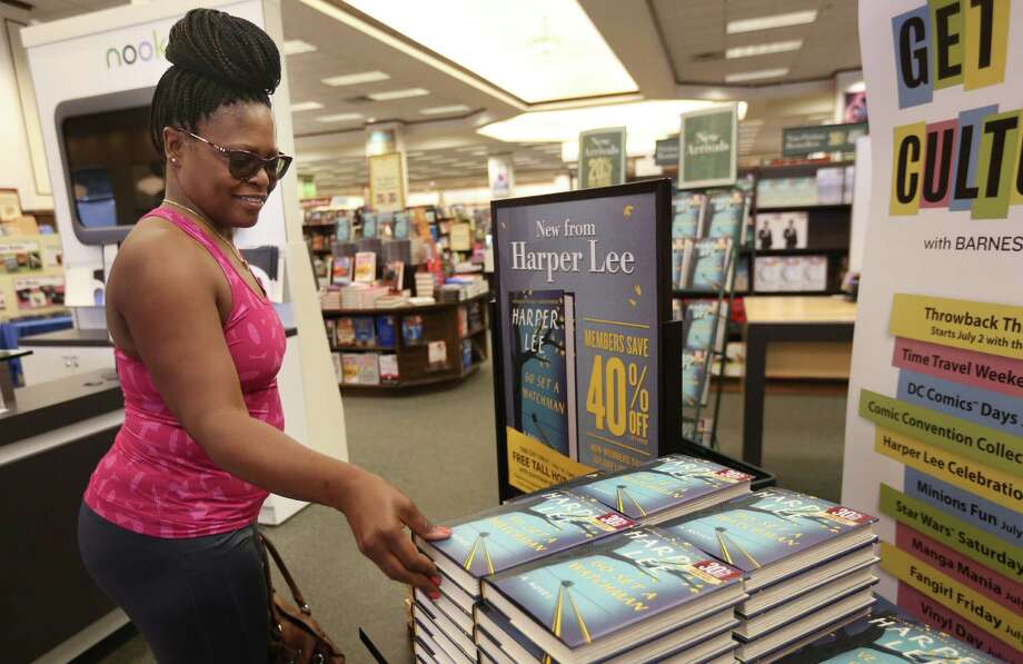 "Vernetta Gonzales buys Harper Lee's  hotly anticipated second novel, ""Go Set a Watchman,"" at the Holcombe Barnes & Noble on Tuesday. Photo: Mayra Beltran, Staff / © 2015 Houston Chronicle"