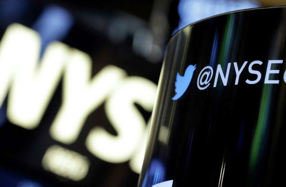 FILE - In this Monday, Nov. 4, 2013, file photo, a phone post on the floor of the New York Stock Exchange features a Twitter logo, in New York. Twitter's stock briefly spiked on Tuesday, July 14, 2015, after a fake story said the company received a $31 billion buyout offer. (AP Photo/Richard Drew, File) Photo: Richard Drew, STF / AP