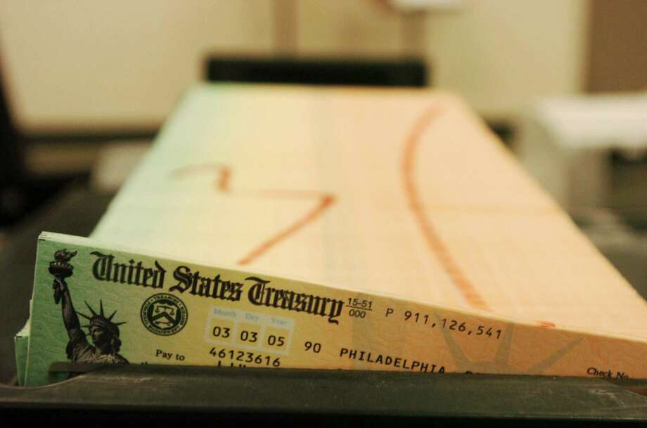 Social Security checks are waiting to be mailed from the U.S. Treasury. Trustees expect the program's trust fund will close 2015 with $2.758 trillion. Photo: Bradley C Bower, STR / AP