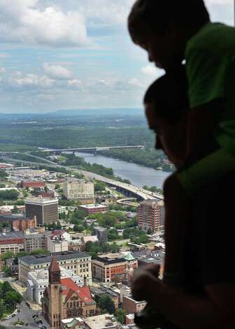 Steven DiBenedetto of Rochester holds his son Antonio DiBenedetto, 4, on his shoulders as they take in a birds-eye-view of the city from the observation deck of the Corning Tower Tuesday July 14, 2015 in Albany, NY.  (John Carl D'Annibale / Times Union) Photo: John Carl D'Annibale / 00032601A