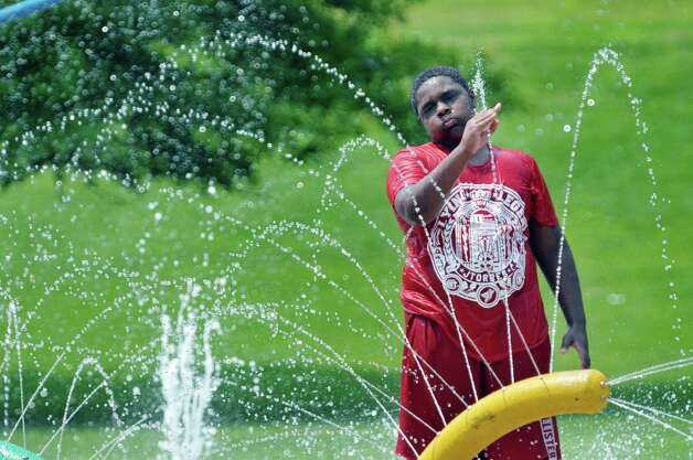 Tavio Jackson, 12, of Albany cools off in the spray pool at Krank Park on Monday, July 13, 2015, in Albany, N.Y.  (Paul Buckowski / Times Union)