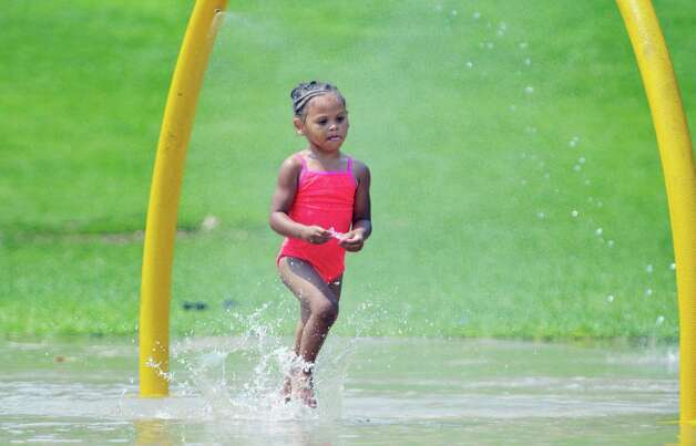 My'Lina Gordon of Albany runs through the water in the spray pool at Krank Park on Monday, July 13, 2015, in Albany, N.Y.  (Paul Buckowski / Times Union)