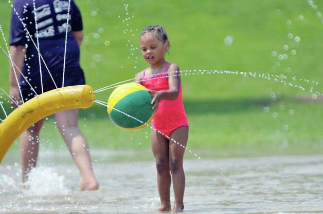 My'Lina Gordon of Albany plays in the spray pool at Krank Park on Monday, July 13, 2015, in Albany, N.Y.  (Paul Buckowski / Times Union)