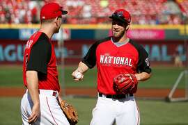 CINCINNATI, OH - JULY 14: National League All-Star Todd Frazier #21 of the Cincinnati Reds speaks with National League All-Star Bryce Harper #34 of the Washington Nationals during batting practice prior to the 86th MLB All-Star Game at the Great American Ball Park on July 14, 2015 in Cincinnati, Ohio.  (Photo by Rob Carr/Getty Images)