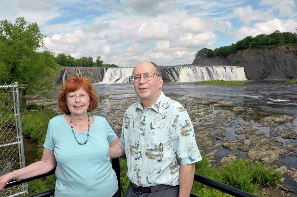 Barb Delaney and her husband Russell Dunn pose for a photograph at the Cohoes Falls on Tuesday, July 14, 2015, in Cohoes, N.Y. The two have collaborated on several books. (Paul Buckowski / Times Union)