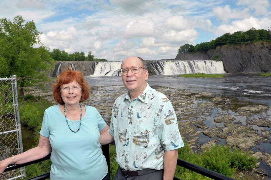 Barb Delaney and her husband Russell Dunn pose for a photograph at the Cohoes Falls on Tuesday, July 14, 2015, in Cohoes, N.Y.  The two have collaborated on several books.  (Paul Buckowski / Times Union) Photo: PAUL BUCKOWSKI / 00032584A