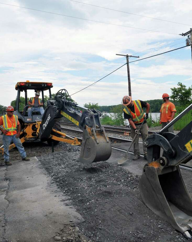 Construction workers work on building new signals for the Rensselaer train station Tuesday, July 14, 2015, in the Town of Schodack, N.Y. (Phoebe Sheehan/Special to The Times Union) Photo: PS / 00032598A