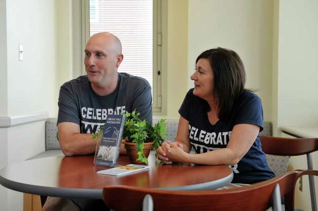 Matt and Tammy Hladun talk about their son Will, who died in 2009 at six months old from a rare form of cancer, as they sit in the Brave Will Room at the Bernard & Millie Duker Children's Hospital at Albany Med on Tuesday, July 14, 2015, in Albany, N.Y.  Their foundation, the Brave Will Foundation, gave a $100,000 gift to the hospital to create the Brave Will Room.  (Paul Buckowski / Times Union) Photo: PAUL BUCKOWSKI / 00032603A