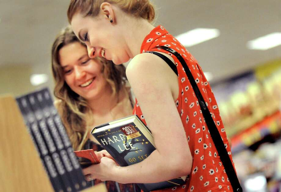 "Friends Katie Drake, 18, center, and Olivia Shipley, 19, both of Clifton Park, continue to shop after picking up Harper Lee's new book ""Go Set a Watchman"" at Barnes and Noble on Tuesday, July 14, 2015, at Colonie Center in Colonie, N.Y. (Cindy Schultz / Times Union) Photo: Cindy Schultz / 00032591A"