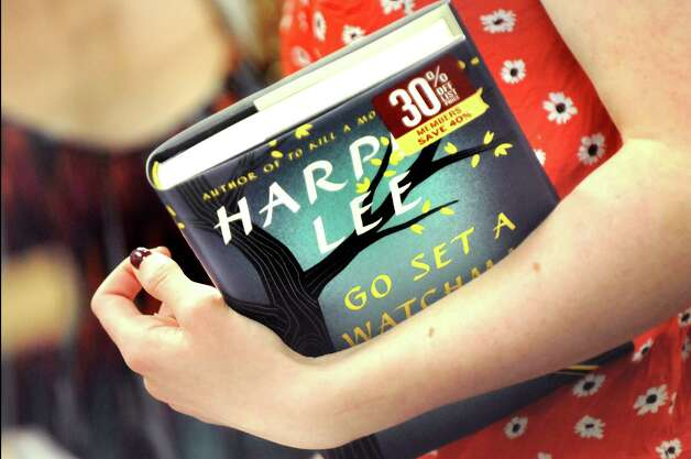 "Katie Drake, 18, of Clifton Park picks up Harper Lee's new book ""Go Set a Watchman"" at Barnes and Noble on Tuesday, July 14, 2015, at Colonie Center in Colonie, N.Y. (Cindy Schultz / Times Union) Photo: Cindy Schultz / 00032591A"