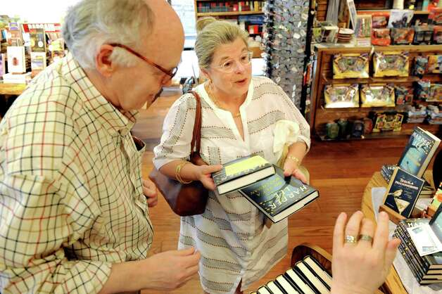 "Kitty Walthausen of Saratoga Springs, center, joins her husband John Walthausen as they pick up reserved copies of Harper Lee's new book ""Go Set a Watchman"" on Tuesday, July 14, 2015, at Northshire Bookstore in Saratoga Springs, N.Y. (Cindy Schultz / Times Union) Photo: Cindy Schultz / 00032591A"